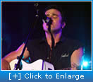 Shannon Noll playing guitar 2006 Gold Coast